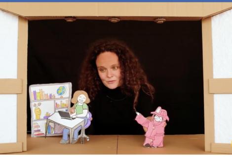 A cardboard puppet theater